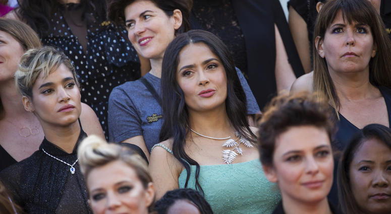 Sofia Boutella, from centre left, Salma Hayek and Patty Jenkins stand as part of 82 film industry professionals on the steps of the Palais des Festivals.