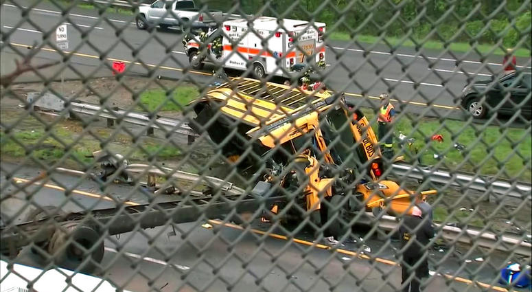 An overturned school bus after it collided with a dump truck, injuring multiple people, on Interstate 80 in Mount Olive, N.J.