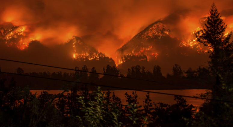 This Sept. 4, 2017, file photo provided by KATU-TV shows a wildfire as seen from near Stevenson, Wash., across the Columbia River, burning in the Columbia River Gorge above Cascade Locks, Ore.