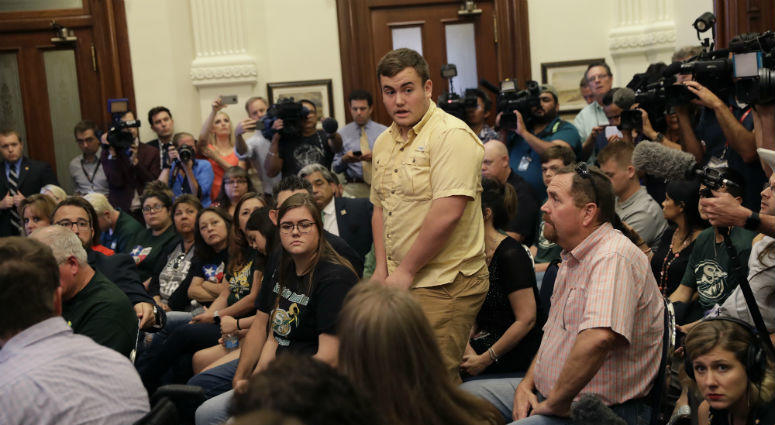 Tyler Morrison, student at Santa Fe High School, Texas, standing center, speaks during a roundtable discussion in Austin, Texas.