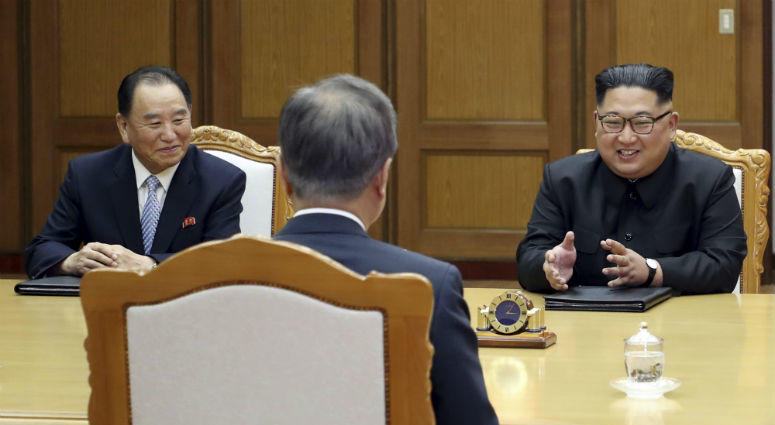 South Korea Presidential Blue House, North Korean leader Kim Jong Un, right, talks with South Korean President Moon Jae-in, center, during a meeting at the northern side of Panmunjom in North Korea.