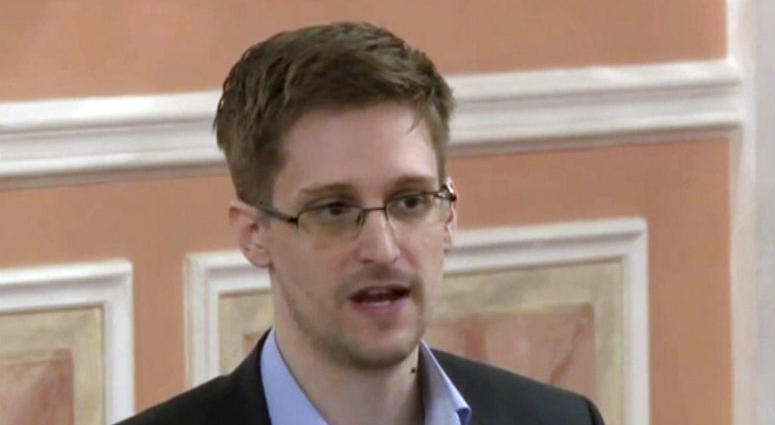 Edward Snowden appears on a live video feed broadcast from Moscow at an event sponsored by ACLU Hawaii in Honolulu.
