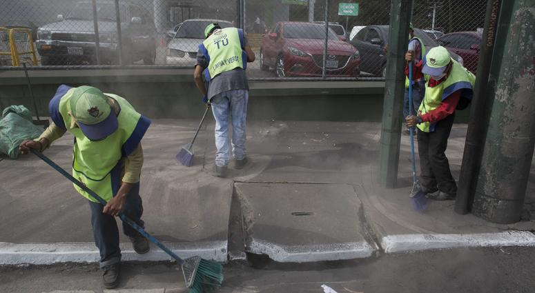 City workers sweep volcanic ash brought by the Volcan del Fuego, in Guatemala City, Sunday, June 3, 2018. Volcan del Fuego is one of the most active volcanoes in Central America.