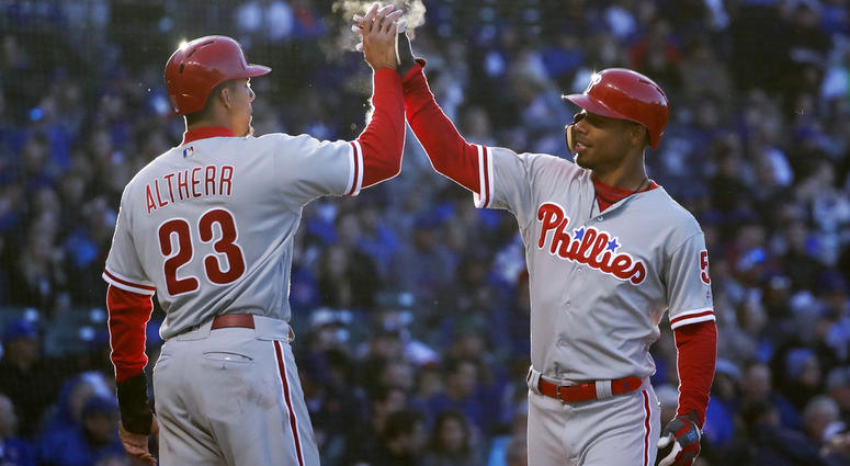 Philadelphia Phillies' Nick Williams, right, celebrates his two-run home run off Chicago Cubs starting pitcher Kyle Hendricks with Aaron Altherr during the second inning.