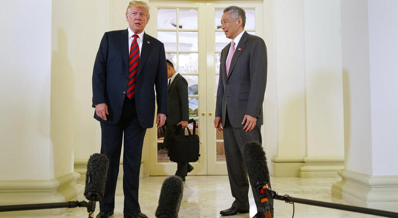 President Donald Trump meets with Singapore Prime Minister Lee Hsien Loong ahead of a summit with North Korean leader Kim Jong Un.