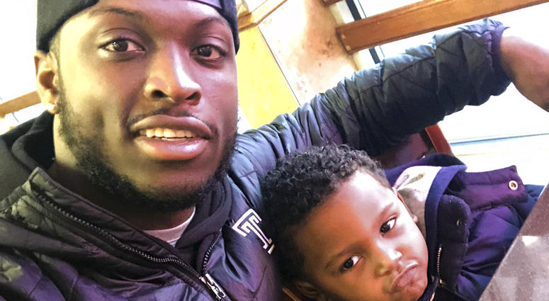 Former Temple running back David Hood takes a selfie with his son, David IV.