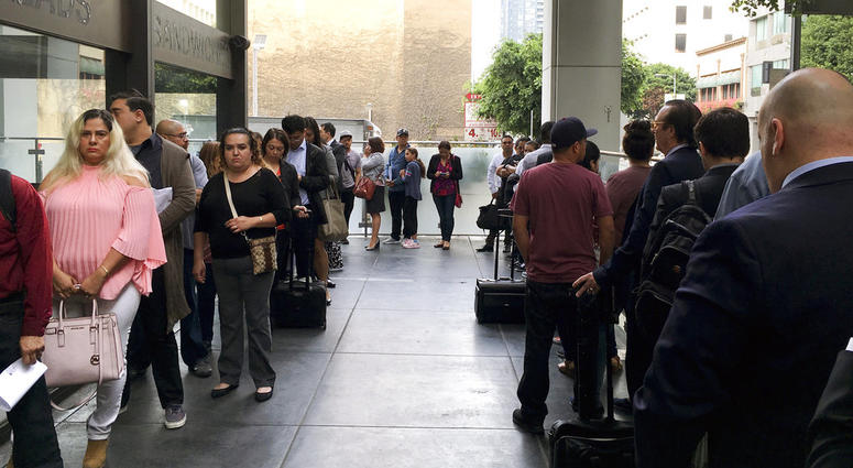 Immigrants awaiting deportation hearings line up outside the building that houses the immigration courts in Los Angeles.