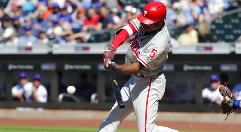 Philadelphia Phillies' Nick Williams (5) hits an RBI-single during the first inning in the first game of a baseball doubleheader against the New York Mets, Monday, July 9, 2018, in New York.