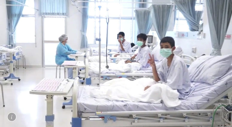 Three of the 12 boys are seen recovering in their hospital beds after being rescued along with their coach from a flooded cave in Mae Sai, Chiang Rai province, northern Thailand.