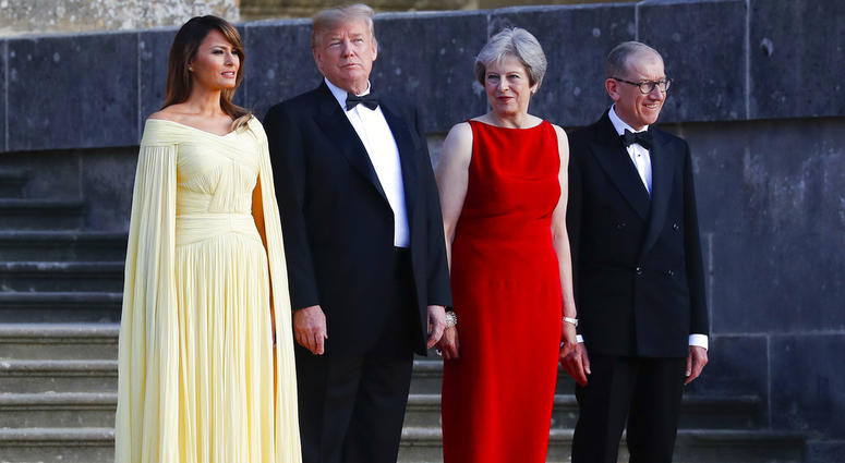 From left, first lady Melania Trump, President Donald Trump, British Prime Minister Theresa May, and her husband Philip May, watch the arrival ceremony at Blenheim Palace, Oxfordshire, Thursday, July 12, 2018.