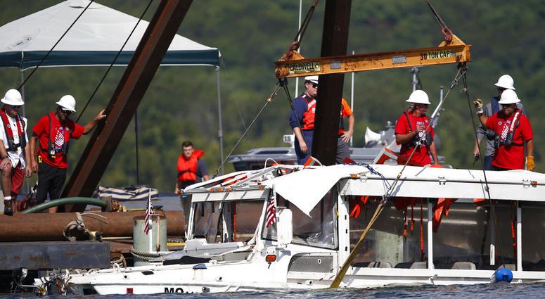 The duck boat that sank in Table Rock Lake in Branson, Mo., is raised Monday, July 23, 2018.