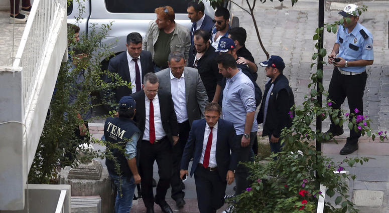 US Pastor Andrew Brunson, second left, arrives at home after his release, following his trial in Izmir, Turkey, Friday, Oct. 12, 2018.