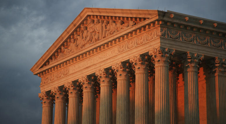 In this Oct. 4, 2018 photo, the U.S. Supreme Court is seen at sunset in Washington.