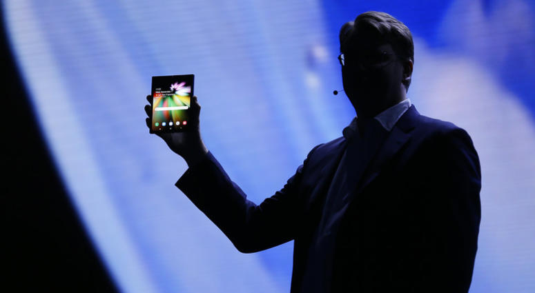 Justin Denison, SVP of Mobile Product Development, shows off the Infinity Flex Display of a folding smartphone during the keynote address of the Samsung Developer Conference, Wednesday, Nov. 7, 2018, in San Francisco.