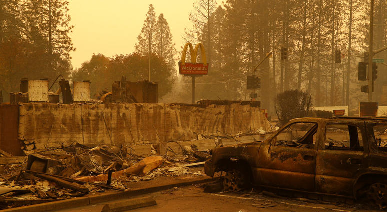 A sign still stands at a McDonald's restaurant burned in the Camp Fire, Monday, Nov. 12, 2018, in the northern California town of Paradise.