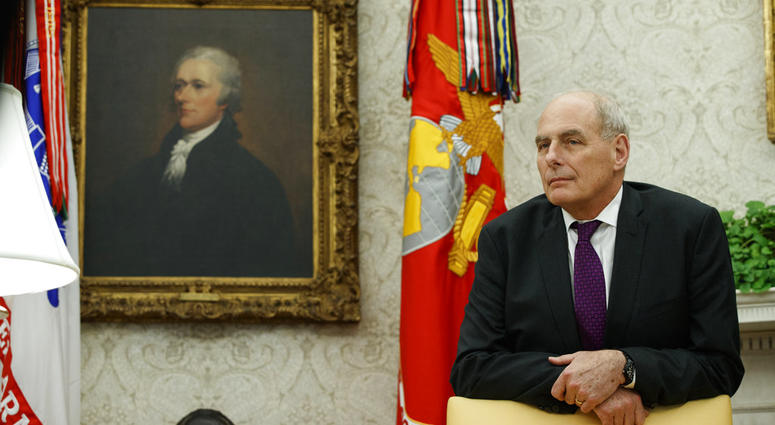 """White House Chief of Staff John Kelly watches as President Donald Trump speaks during a signing ceremony for the """"Cybersecurity and Infrastructure Security Agency Act,"""" in the Oval Office of the White House, Friday, Nov. 16, 2018, in Washington."""