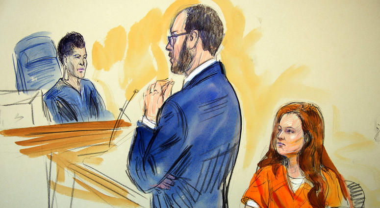 FILE - This July 18, 2018, file courtroom sketch depicts Maria Butina, listening to Assistant U.S. Attorney Erik Kenerson as he speaks to Judge Deborah Robinson, left, during a hearing in federal court in Washington.