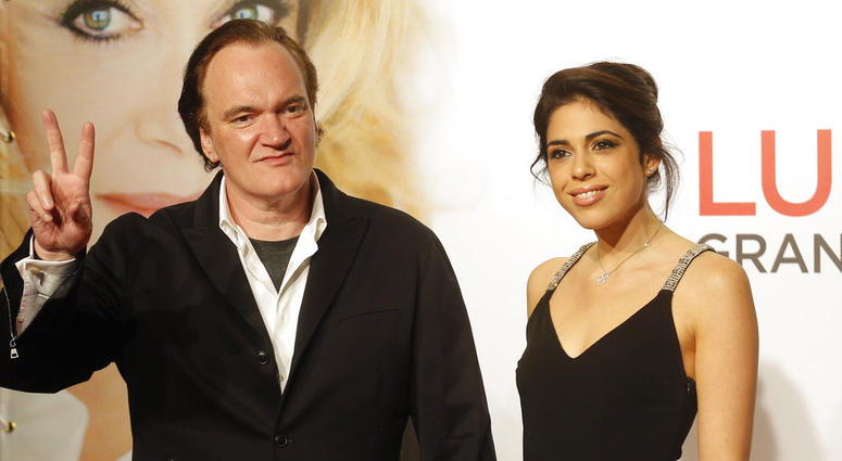 FILE - In this Oct. 8, 2016 file photo, director Quentin Tarantino, left, and singer Daniella Pick arrive at the opening ceremony of the 8th Lumiere Festival in Lyon, central France.