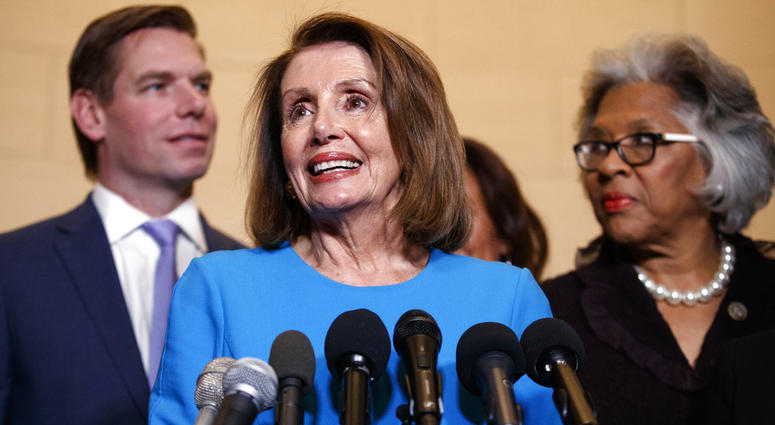 House Minority Leader Nancy Pelosi, joined by Rep. Eric Swalwell (left), and Rep. Joyce Beatty, speaks to media at Longworth House Office Building on Capitol Hill, Nov. 28, 2018, to announce her nomination by House Dems to lead them in the new Congress.