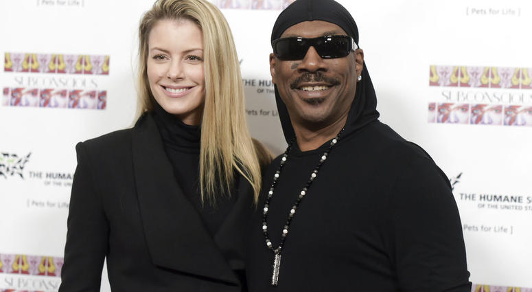 "FILE - In this Nov. 20, 2016, file photo, Paige Butcher, left, and Eddie Murphy attend ""SUBCONSCIOUS"" by Bria Murphy Gallery Opening at Lace Gallery in Los Angeles."