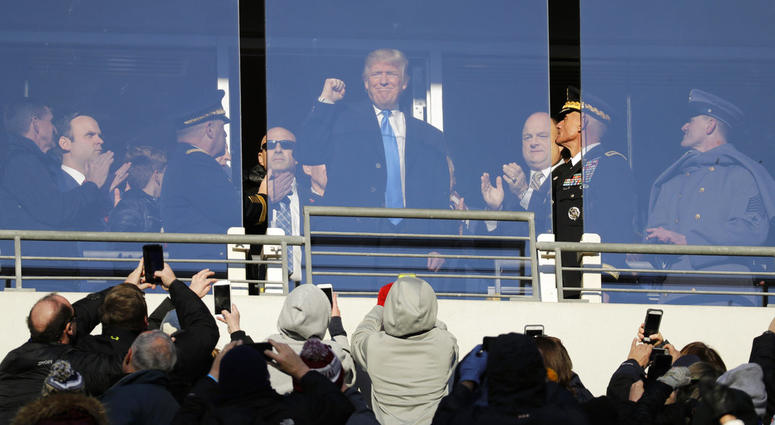 In this Saturday, Dec. 10, 2016, file photo, then President-elect Donald Trump acknowledges spectators during the first half of the Army-Navy NCAA college football game in Baltimore.