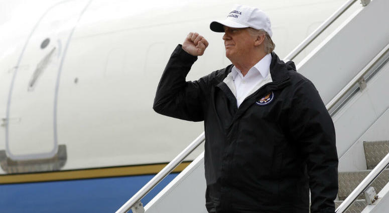 President Donald Trump gestures after arriving at McAllen International Airport for a visit to the southern border, Thursday, Jan. 10, 2019, in McAllen, Texas.