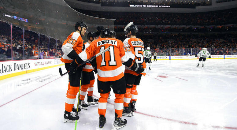 Philadelphia Flyers' Travis Konecny (11) celebrates with teammates after scoring a goal against the Dallas Stars during the second period of an NHL hockey game Thursday, Jan. 10, 2019, in Philadelphia.