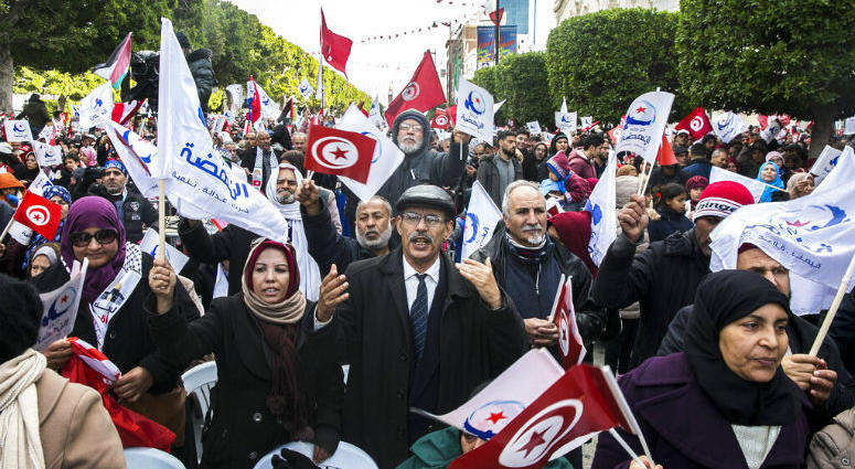 Followers of moderate islamist party Ennahdha march to celebrate the eighth anniversary of the democratic uprising in Tunis, Monday, Jan.14, 2019.
