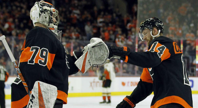 Philadelphia Flyers' Carter Hart, left, congratulates Sean Couturier on his goal during the first period of an NHL hockey game against the Anaheim Ducks, Saturday, Feb. 9, 2019, in Philadelphia.