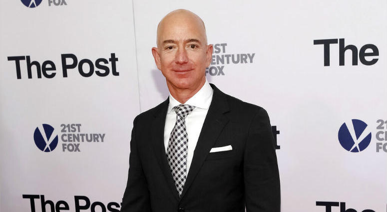 "FILE - In this Dec. 14, 2017, file photo, Jeff Bezos attends the premiere of ""The Post"" at The Newseum in Washington."