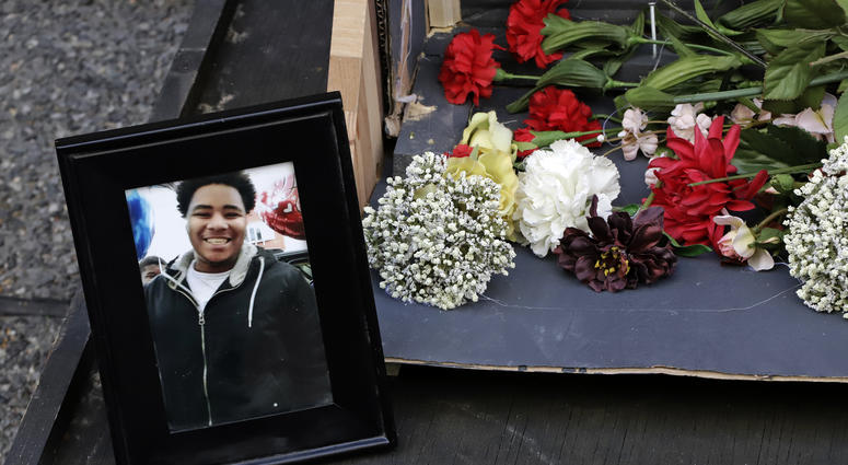 A photo of Antwon Rose II sits with a memorial display for Rose II in front of the Allegheny County courthouse on the second day of the trial for Michael Rosfeld, a former police officer in East Pittsburgh, Pa., Wednesday, March 20, 2019.