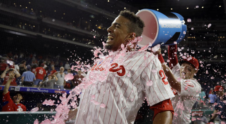 Philadelphia Phillies' Aaron Altherr, left, is doused by Rhys Hoskins after Altherr hit a game-winning two-run double off St. Louis Cardinals relief pitcher Matt Bowman during the 10th inning of a baseball game, Monday, June 18, 2018, in Philadelphia.