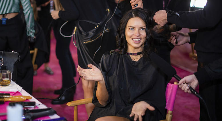Adriana Lima appears backstage during hair and makeup at the 2018 Victoria's Secret Fashion Show at Pier 94 on Thursday, Nov. 8, 2018, in New York.