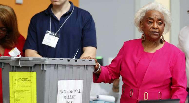 Broward County Supervisor of Elections Brenda Snipes, right, shows a ballot box that was found in a rental car after the elections and turned out to only contain election day supplies, as election employees sort ballots and prepare to count them.