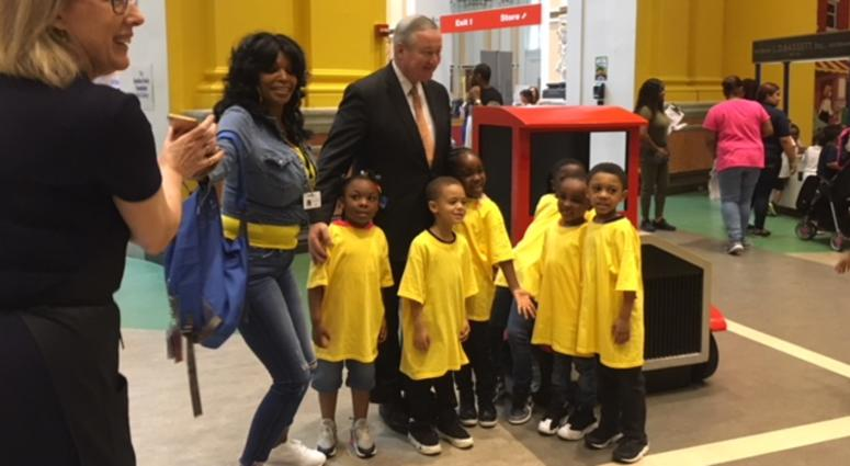 Mayor Jim Kenney stands with pre-K students at the Please Touch Museum in Philadelphia.