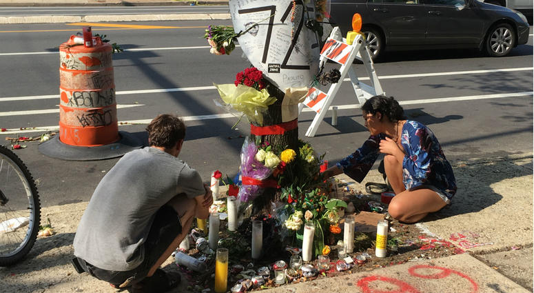 Activists create a makeshift memorial at 10th and Spring Garden streets, where bicyclist Pablo Avendano was killed Saturday.