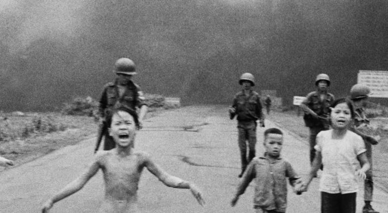 In this June 8, 1972 file photo, South Vietnamese forces follow after terrified children, including 9-year-old Kim Phuc.