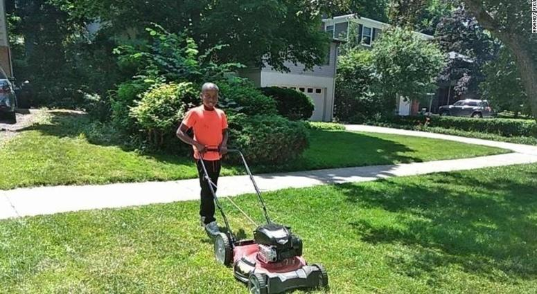Reggie Fields, 12, mows a lawn Sunday in Maple Heights, Ohio. His mom says he's picked up about 20 new customers since someone called the police on him for mowing the wrong yard.