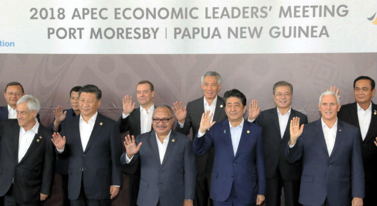 Leaders of 21 Asia-Pacific Economic Cooperation forum economies pose for photos before their meeting in Port Moresby, Papua New Guinea.