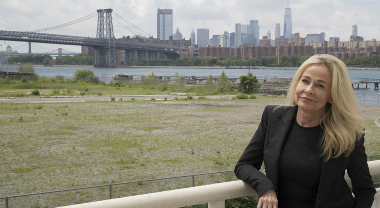 In this June 28, 2018 photo, Sabine Anton poses for a photo on the balcony of her apartment in the building overlooking lower Manhattan and the Williamsburg bridge at 184 Kent Avenue in the Brooklyn borough of New York.