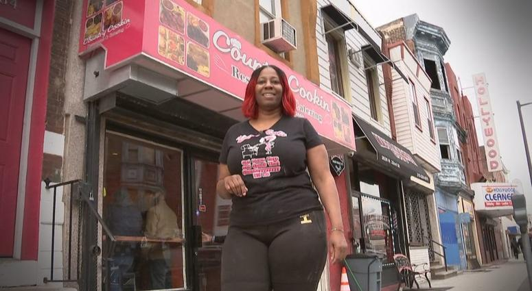 Saudia Shuler poses in front of her North Philly restaurant Country Cookin'.
