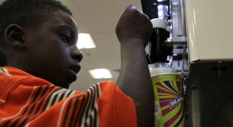 Ray Jenkins, 6, makes a Slurpee at a 7-Eleven in Baltimore.