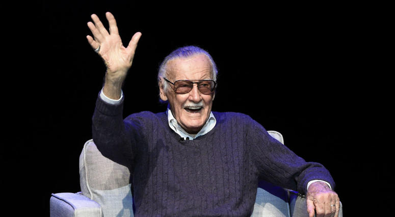 """In this Aug. 22, 2017, file photo, comic book writer Stan Lee waves to the audience after being introduced onstage at the """"Extraordinary: Stan Lee"""" tribute event at the Saban Theatre in Beverly Hills, Calif."""