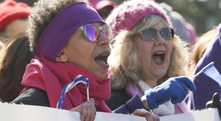 Jan 20, 2018; Philadelphia, PA, USA; Diane Postell of Wilmington, Del. (left) and Angela O'Connor of Churchville, Md. cheer with a Delaware contingent taking part in the Women's March in Philadelphia.