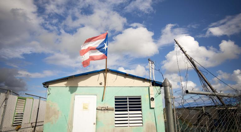 A house with a Puerto Rican flag Puerto Rico.