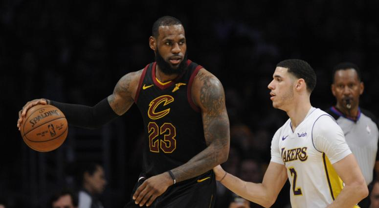 leveland Cavaliers forward LeBron James (23) moves the ball against Los Angeles Lakers guard Lonzo Ball (2) during the second half at Staples Center.