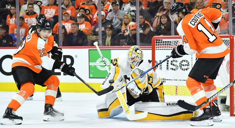 Apr 15, 2018; Philadelphia, PA, USA; Pittsburgh Penguins goaltender Matt Murray (30) blocks a shot as Philadelphia Flyers center Nolan Patrick (19) and center Sean Couturier (14) deflect the puck during the second period in game three of the first round o