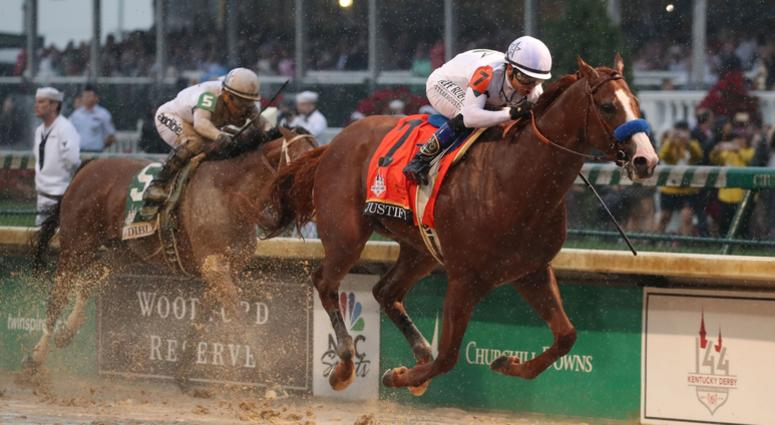 May 5, 2018; Louisville, KY, USA; Mike Smith aboard Justify (7) beats Javier Castellano aboard Audible (5) to the finish line to win the 144th running of the Kentucky Derby at Churchill Downs. Mandatory Credit: Mark Zerof-USA TODAY Sports