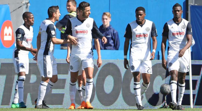 Philadelphia Union forward Cory Burke (19) celebrates with teammates after scoring a goal against Montreal Impact with teammates during the first half at Stade Saputo. Mandatory Credit: Jean-Yves Ahern-USA TODAY Sports