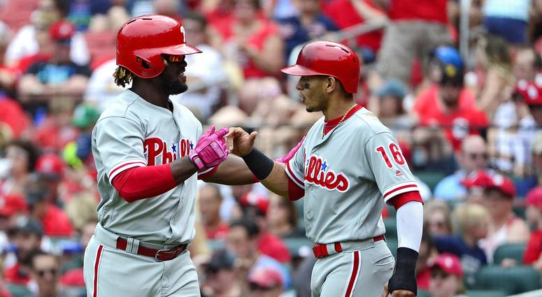 May 19, 2018; St. Louis, MO, USA; Philadelphia Phillies center fielder Odubel Herrera (37) is congratulated by second baseman Cesar Hernandez (16) after hitting a two run home run off of St. Louis Cardinals starting pitcher John Gant (not pictured) during